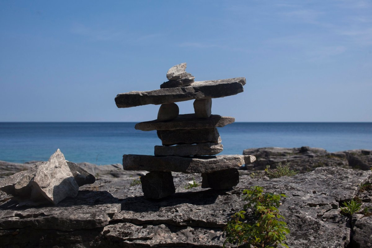 A small inukshuk is seen on a rock beach in Ontario's Bruce Peninsula National Park on August 4, 2016.