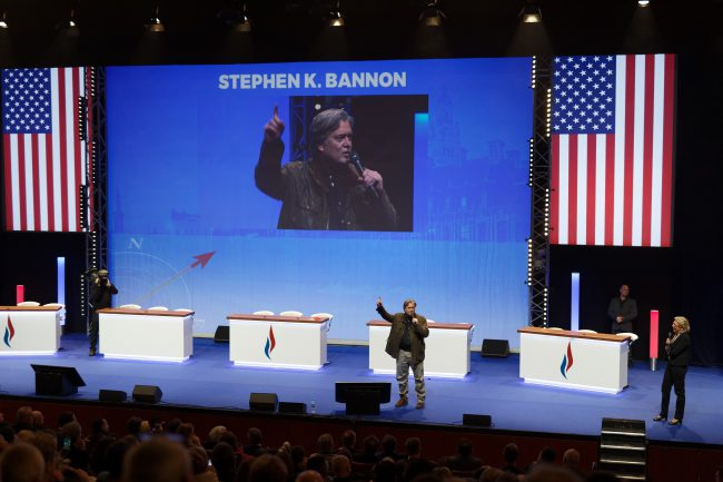 Steve Bannon addresses the French far-right Front National party's annual congress in Lille as party leader Marine Le Pen looks on, March 10, 2018.