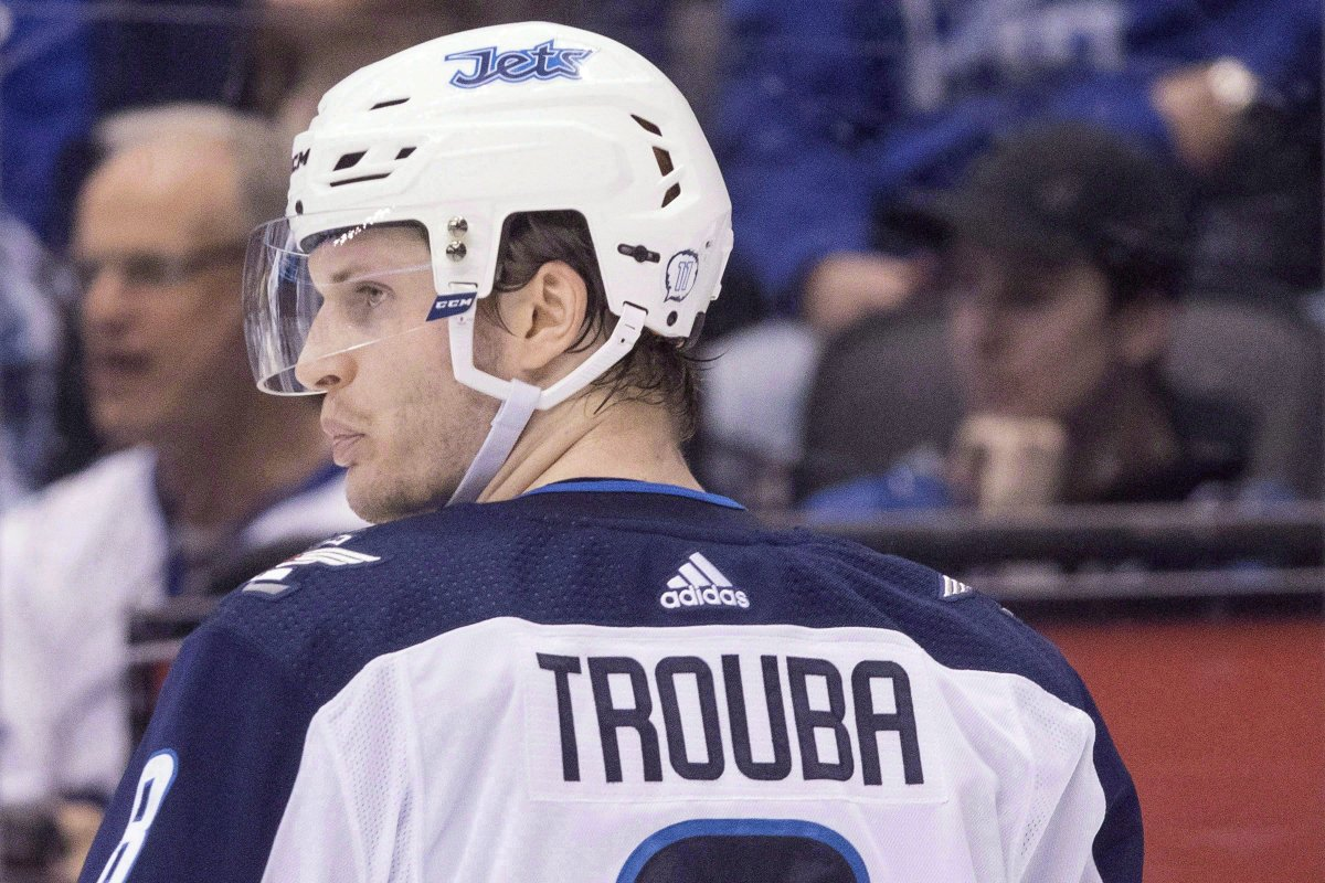 Winnipeg Jets' Jacob Trouba (8) is seen in action during second period NHL hockey action against the Toronto Maple Leafs, in Toronto on Saturday, March 31, 2018.
