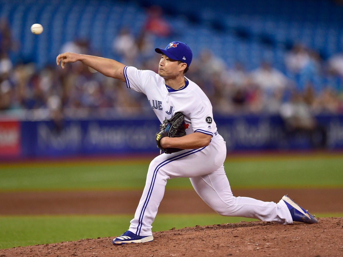 Toronto Blue Jays relief pitcher Seunghwan Oh (22) throws against the Detroit Tigers during eighth inning American League baseball action in Toronto on Friday, June 29, 2018.