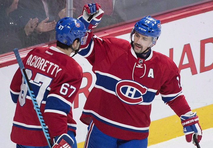 In this file photo, Montreal Canadiens' captain Max Pacioretty (67) celebrates with teammate Tomas Plekanec. Plekanecwho was dealt to the Leafs in February is back with the Habs after signing a one-year contract for US$2.25 million. Sunday, July 1, 2018.