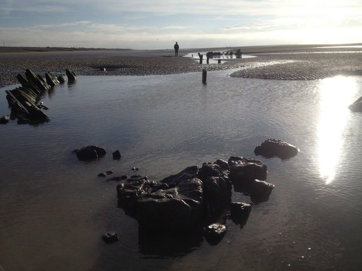 Remnants of a shipwreck on Camber Sands, England, is seen in this undated handout photo. Researchers say remnants of a 175-year-old ship washed up on an England beach could be from a Nova Scotian vessel.