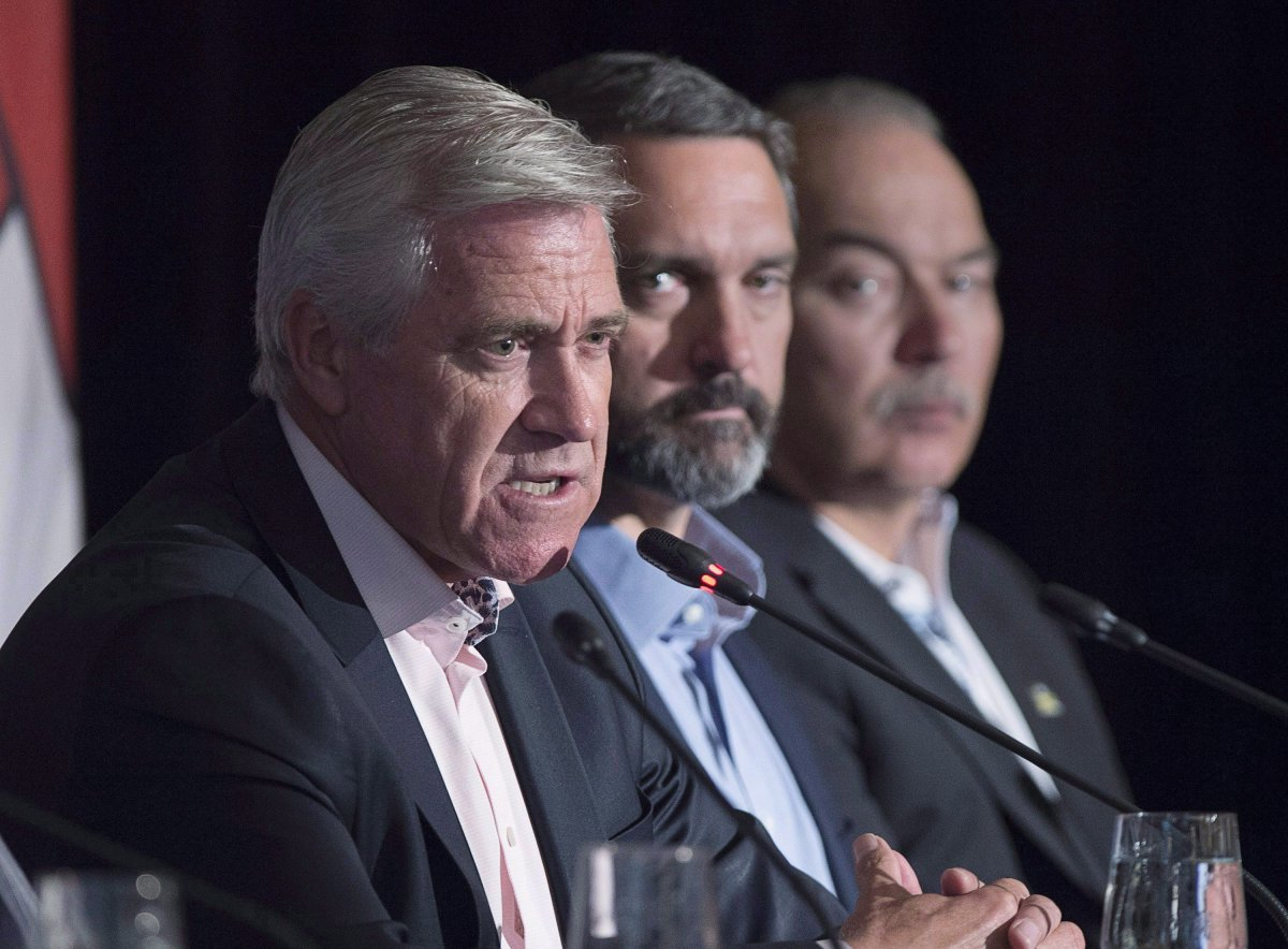 Newfoundland and Labrador Premier Dwight Ball, left, fields a question as Nunavut Premier Joe Savikataaq, right, and Yukon Premier Sandy Silver look on at the closing news conference of the Canadian premiers meeting in St. Andrews, N.B. on Friday, July 20, 2018.