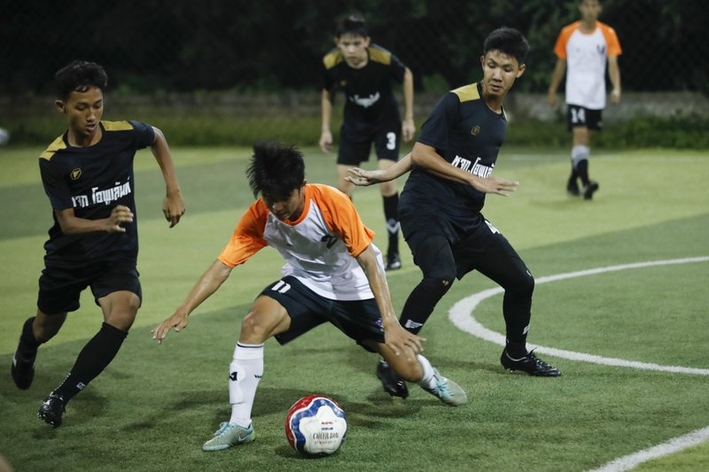 × None In this July 15, 2018, photo, Wild Boars football team, in black, play a local team during a Mae Sai football league soccer match in Mae Sai district in Chiang Rai province, northern Thailand. At least 3 of the 12 boys and coach of another local team who were rescued from a cave in northern Thailand last week are stateless, living in a limbo that puts serious restrictions not only on their upward mobility, but even on their right to travel outside of Chiang Rai, the northern province where they live.