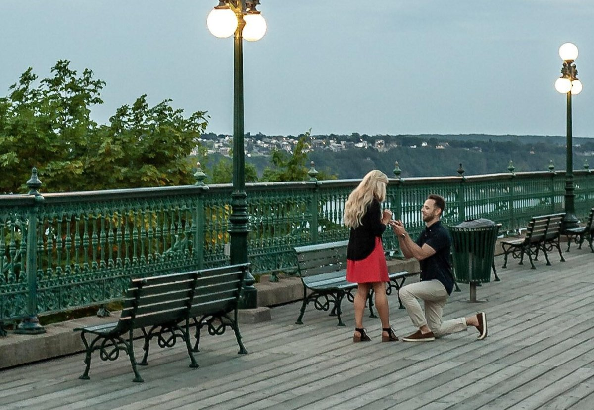 A photographer is looking for a couple after capturing an intimate moment in Quebec City.