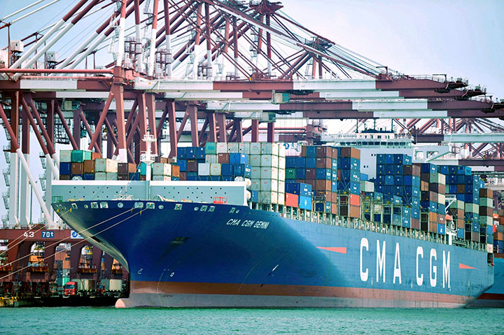 In this July 6, 2018, photo, a container ship is docked at a port in Qingdao in eastern China's Shandong Province.