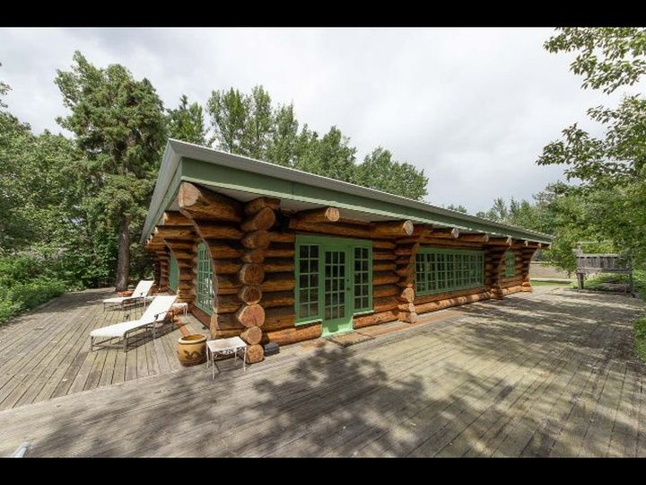 This photo appears on a real estate listing for Daryl Katz's custom-designed, hand-crafted log cabin on Pigeon Lake.