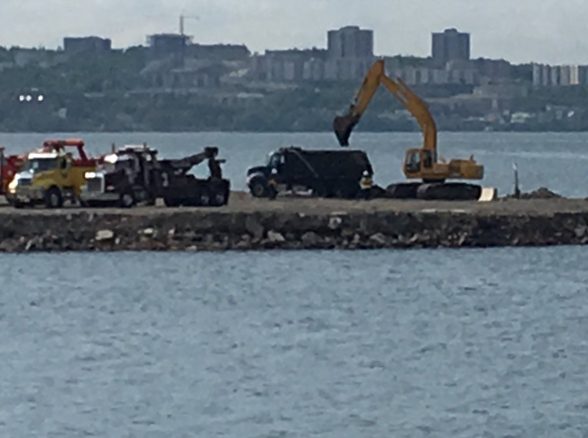 Nova Scotia's Department of Labour has confirmed a dump truck pulled from the water at the Fairview Cove Sequestration Facility is related to their investigation into a fatal workplace incident.
