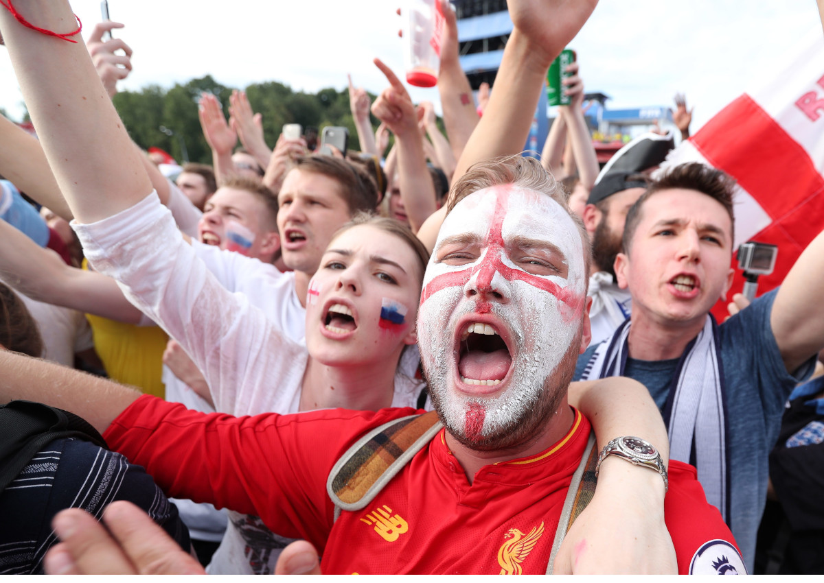 England fans celebrate their team scoring as he watches the FIFA World Cup 2018 quarter final match between England and Sweden at the Fan Fest in Moscow.