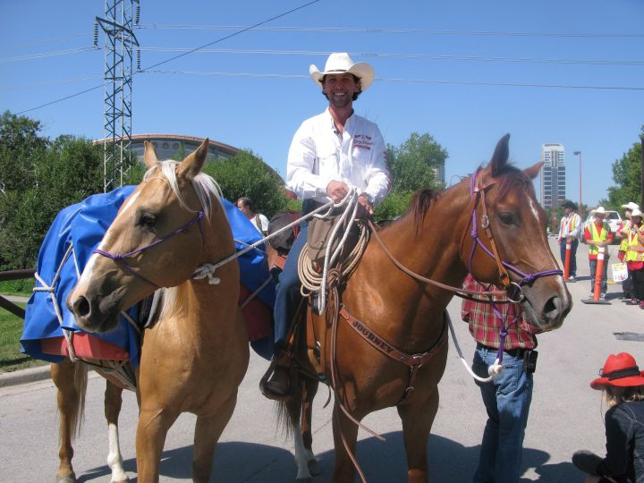 Filipe Masetti Leite rides out of the Stampede grounds in Calgary on July 8, 2012. Leite, who embarked on a two year journey from Calgary to Sao Paolo, Brazil, is now planning on riding his horse from Alaska to Calgary next year.