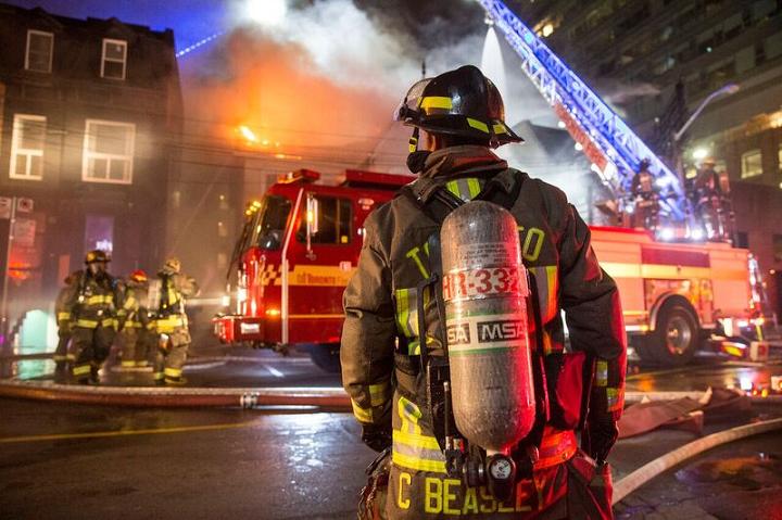 Toronto firefighters battle a 3-alarm fire on Peter Street overnight Friday.