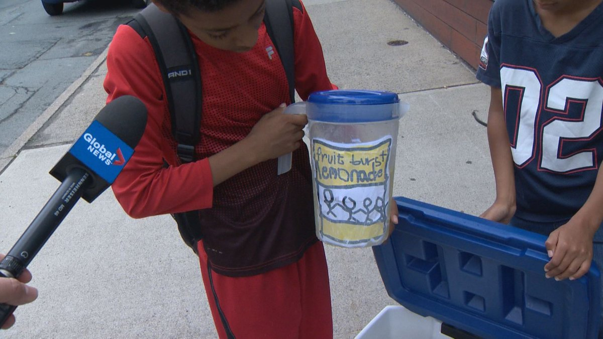 Adrius Stephenson with his team's homemade lemonade pictured in Halifax on July 18, 2018.