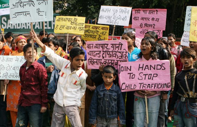 In this Dec. 12, 2008 file photo, Indian children shout slogans during a demonstration on the Global Day against Child Trafficking in New Delhi.
