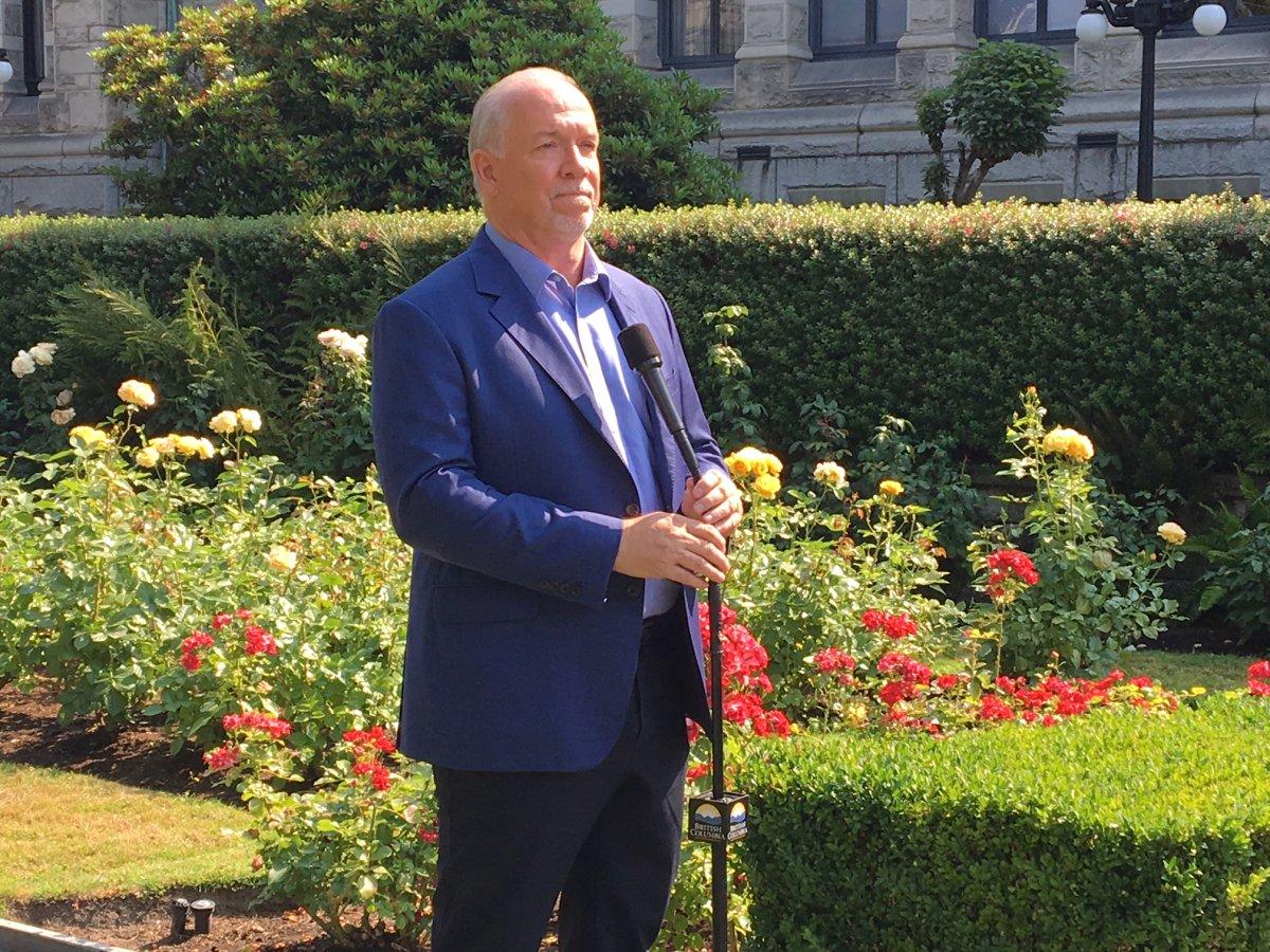 Premier John Horgan speaks to reporters on July 30, 2018 in Victoria.