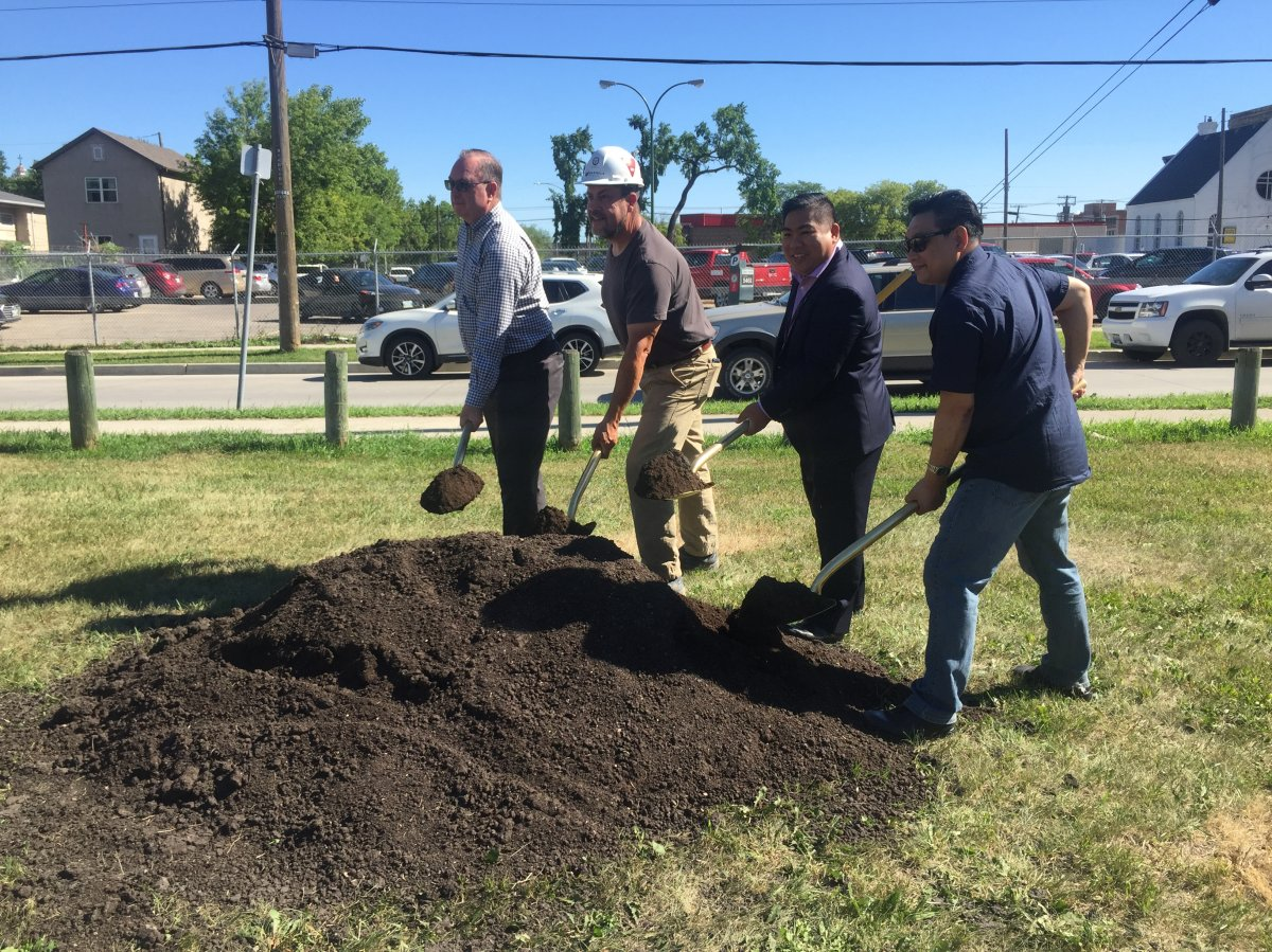 Councillor Mike Pagtakhan, second from right, and Gord Dong, right, help break ground on Gord Dong Park's redevelopment.