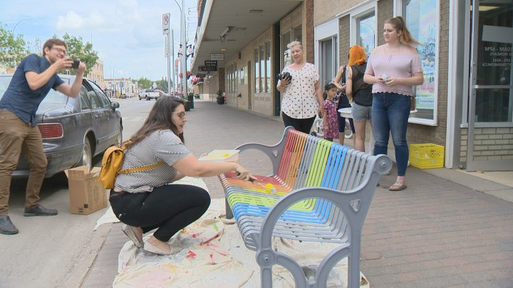 Gearing up for the 25th anniversary of Pride week, members of Moose Jaw Pride invited the community on Friday to help paint the bench outside of Rainbow Retro Thrift Shop with Pride colours.