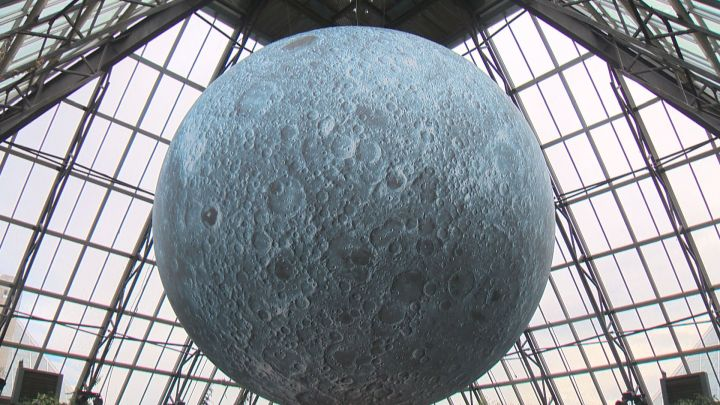 A massive moon has been inflated inside one of the conservatory's pyramids for the first time in Canada.