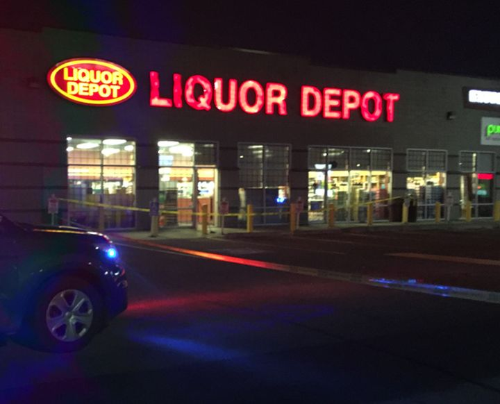 Police tape can be seen outside an Edmonton liquor store in the area of 97 Street and 160 Avenue on Thursday night.