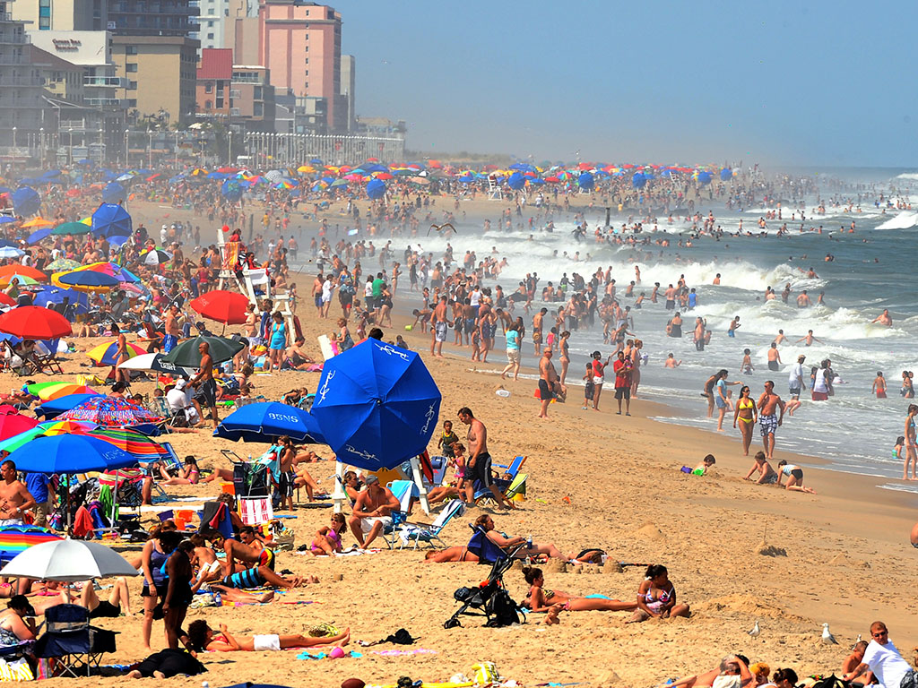 A woman was impaled by a beach umbrella on Sunday while lounging at Ocean City beach.