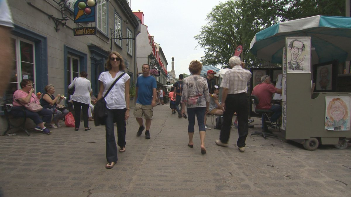 FILE: Tourists walk around in Old Quebec City  on Thursday, July 26, 2018.