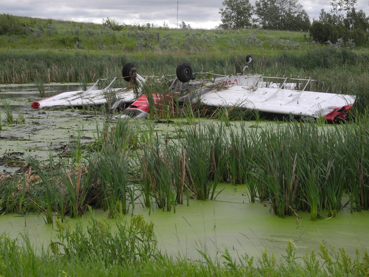 A plane flipped into a boggy area near Russel, Man. on Wednesday, July 4, 2018.