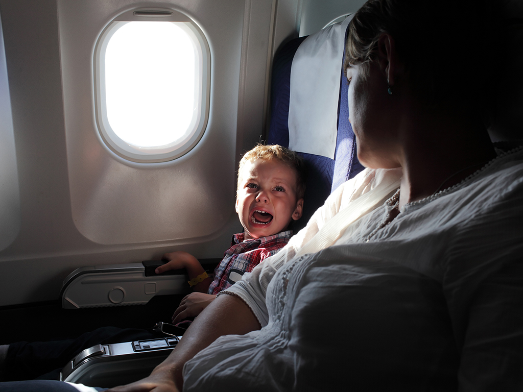 Parents are strongly divided on the practice of giving kids sedatives when they travel.