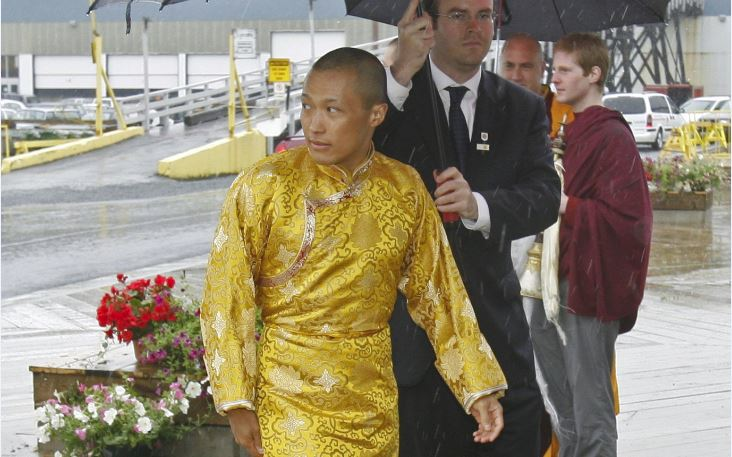 FILE - Sakyong Mipham Rinpoche arrives in the rain for his Tibetan Buddhist royal wedding to Princess Tseyang Palmo in Halifax on Saturday, June 10, 2006.