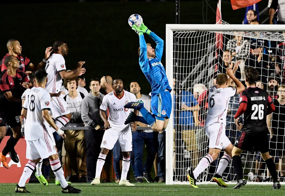 Toronto FC goalkeeper Clint Irwin (1) makes a save against the Ottawa Fury FC during second half Canadian Championship soccer action in Ottawa on Wednesday, July 18, 2018.