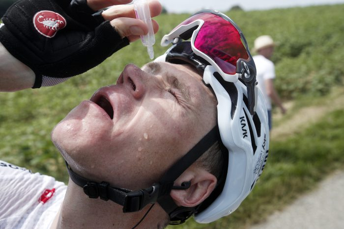 Team Sky rider Chris Froome of Britain cleans his eyes after tear gas was used by policemen against protesting farmers between Carcassonne and Bagneres-de-Luchon, France, 24 July 2018.