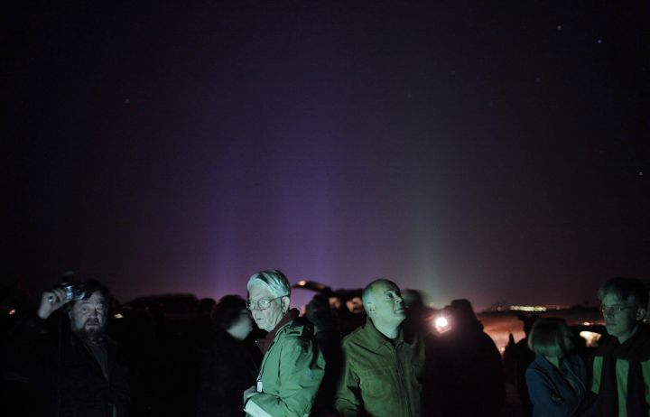 A group of attendees gather in a desert area for UFO sightings at the Annual International UFO Congress Convention Convention & Film Festival in Laughlin, Nev., on February 26, 2009. Hovering lights in the sky. Pulsing lights. A humming noise. Objects shaped like spheres, discs, triangles and boomerangs. The witnesses include ordinary folk, airline crews, a particle physicist and an airport's weather observer. A survey released by Manitoba-based Ufology Research on Tuesday says there were 1,101 UFO sightings -- an average of three a day -- reported in Canada in 2017.