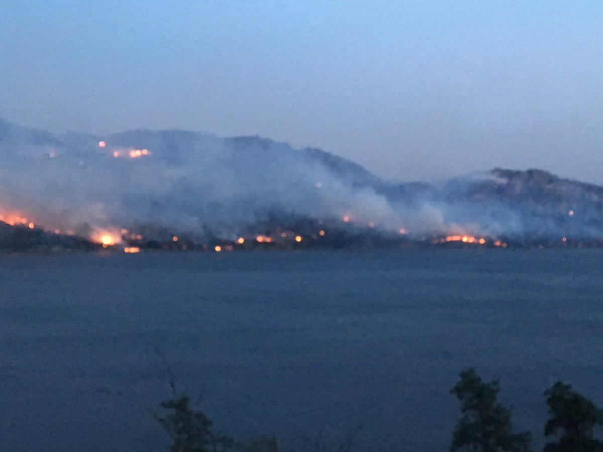 The Mount Eneas fire continues to be classified by BC Fire Service as Out of Control but more residents are being allowed back into their homes.