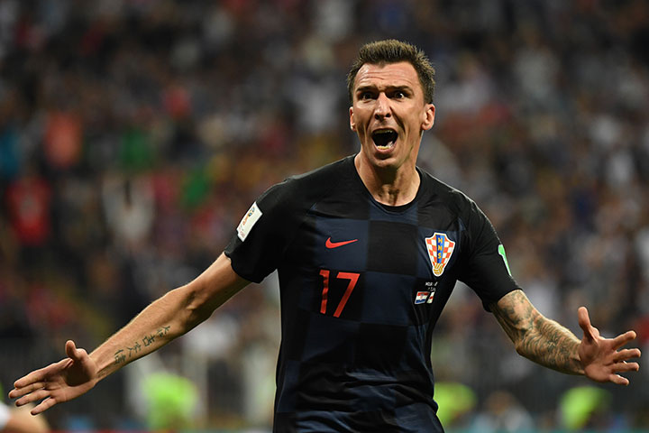 Croatia's forward Mario Mandzukic celebrates after scoring his team's second goal during the Russia 2018 World Cup semi-final match between Croatia and England at the Luzhniki Stadium in Moscow on July 11, 2018.