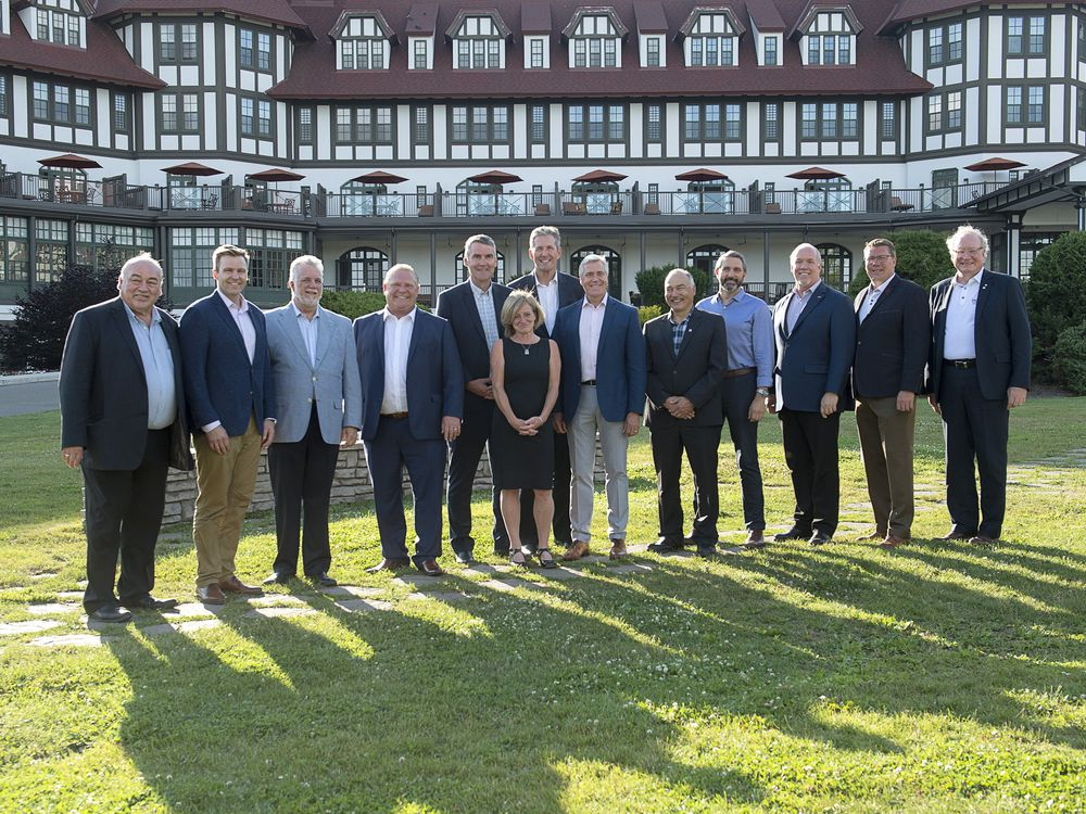 Visiting premiers pose for an official photo on the lawn of the Algonquin Resort as the Canadian premiers meet in St. Andrews, N.B., on Wednesday, July 18, 2018.