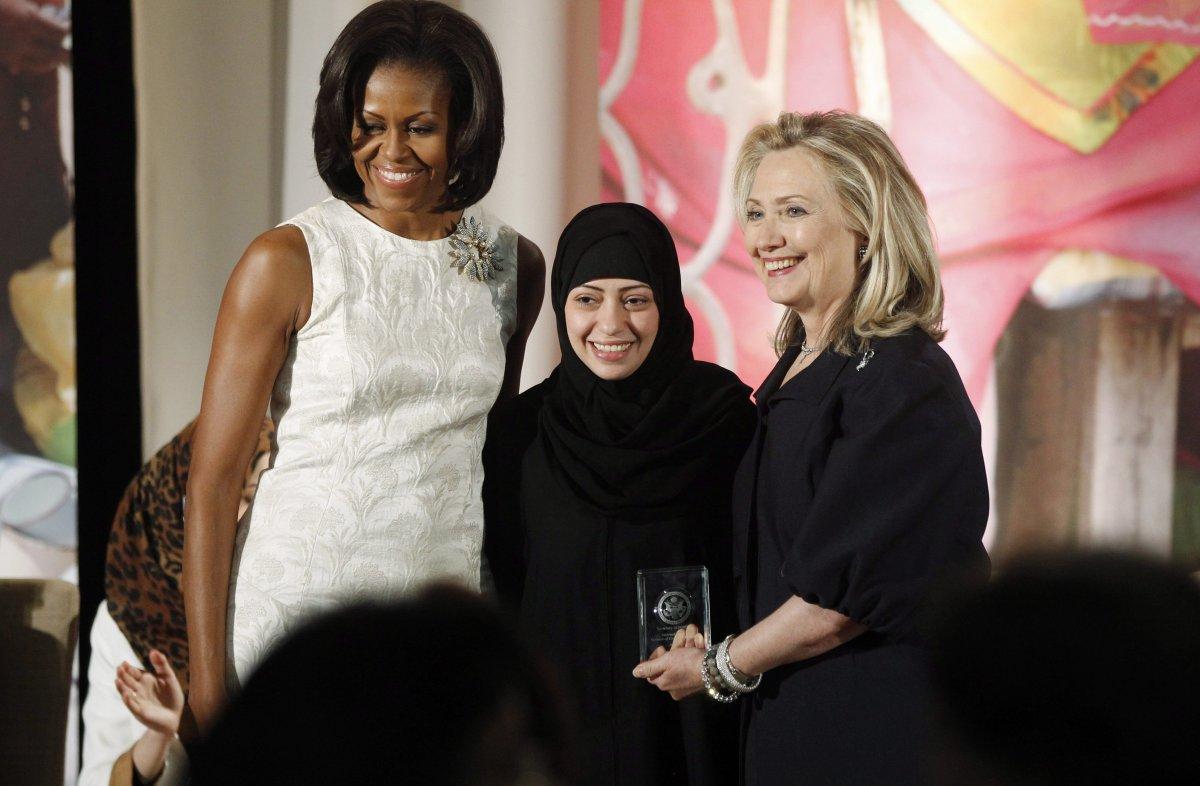 Secretary of State Hillary Rodham Clinton and first lady Michelle Obama present the 2012 International Women of Courage Award to Samar Badawi of Saudi Arabia.