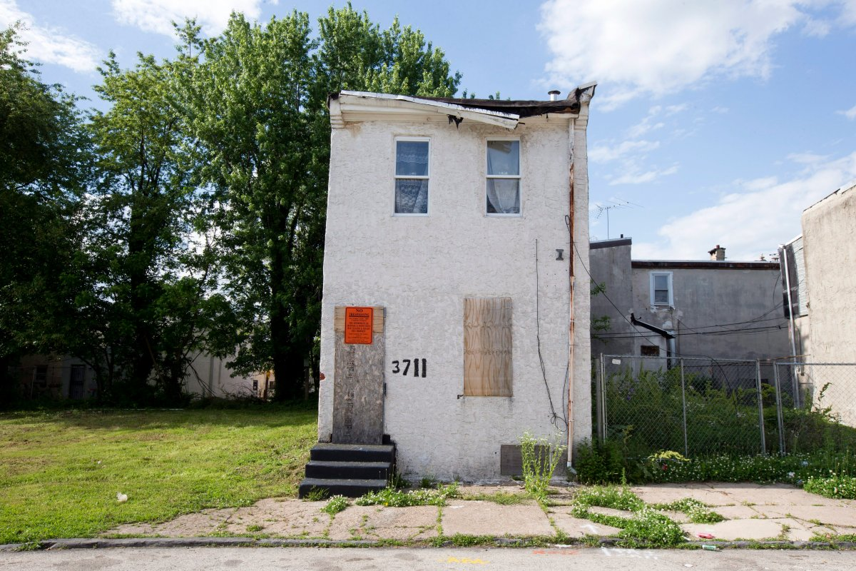 This Friday, May 23, 2014 photo, shows an abandoned home in the impoverished Mantua section of Philadelphia, before it was knocked down.
