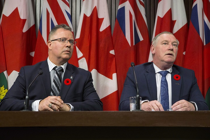 President of the Police Association of Ontario Bruce Chapman (right) and President of the Ontario Provincial Police Association Rob Jamieson attend a news conference at the Queens Park Legislature in Toronto on Thursday Nov. 2, 2017.
