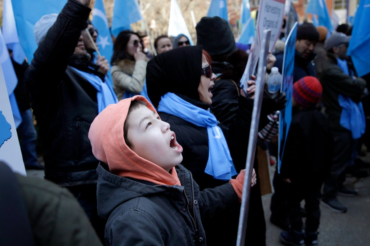 Uighurs and their supporters protest in front of the Permanent Mission of China to the United Nations in New York, Thursday, March 15, 2018.