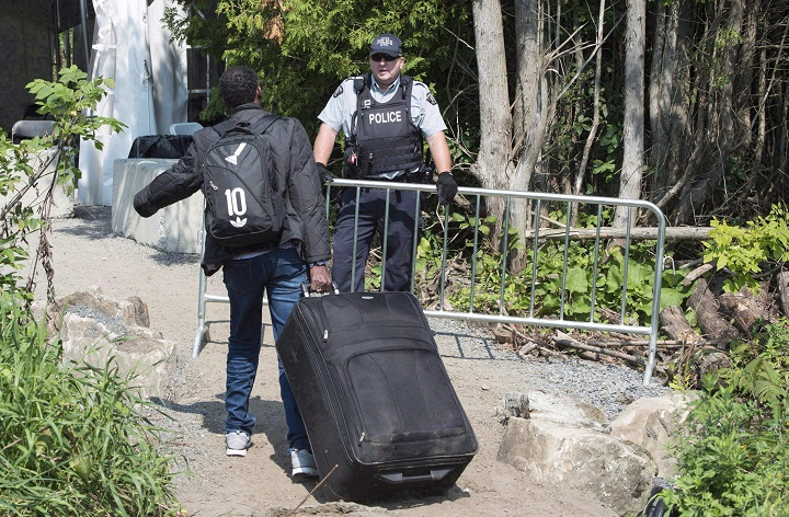 Conservative Leader Andrew Scheer says Canada's asylum seeker situation is now a crisis.