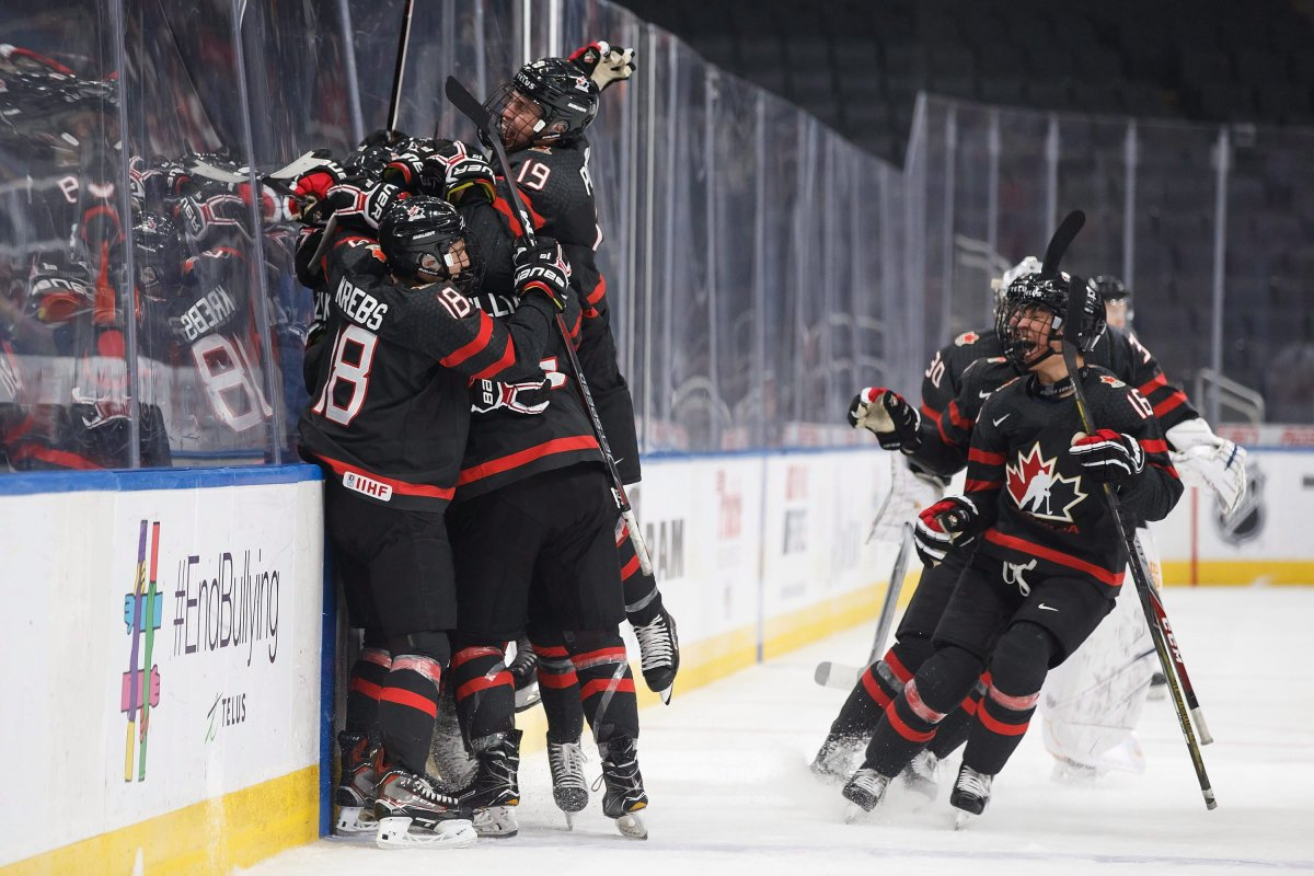 Canada celebrates the game-winning goal during overtime Hlinka Gretzky Cup semifinal action against the United States, in Edmonton on Friday.