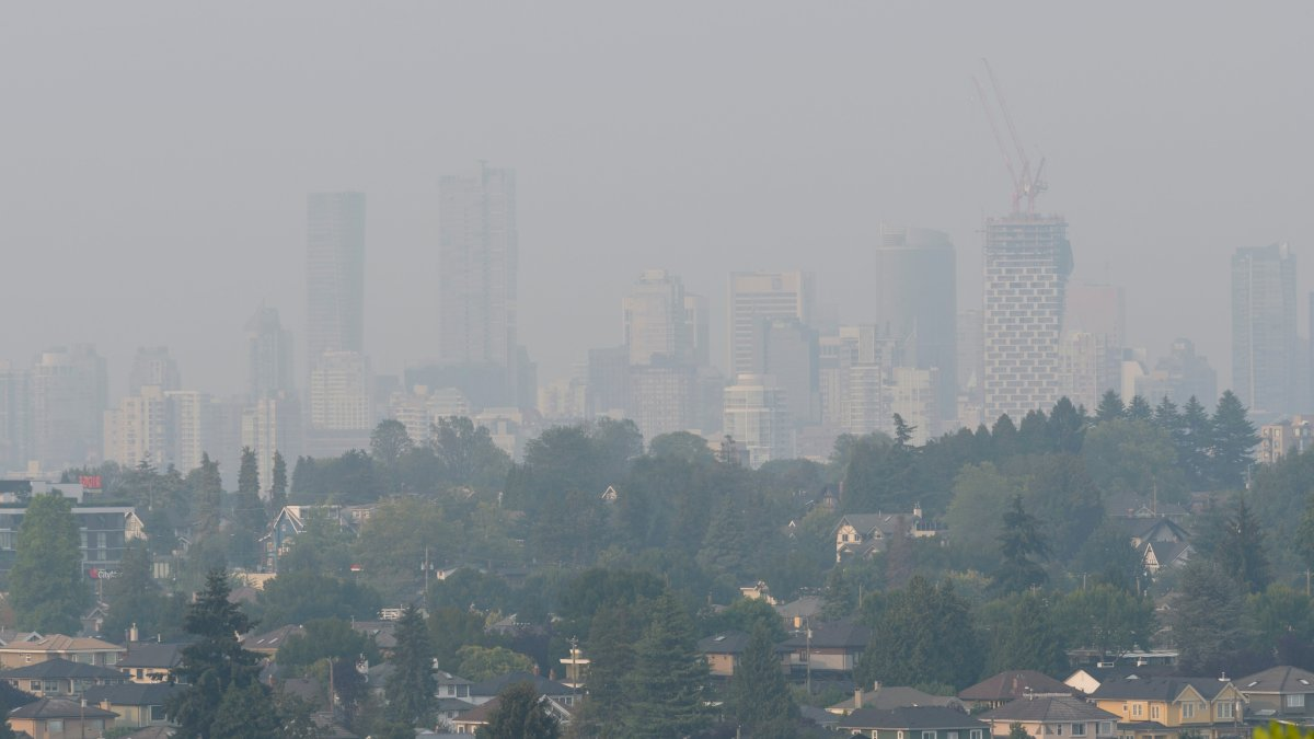Smoke from distant wildfires obscures the view as a heavy haze blankets the city of Vancouver, B.C. on Tuesday, August 14, 2018.