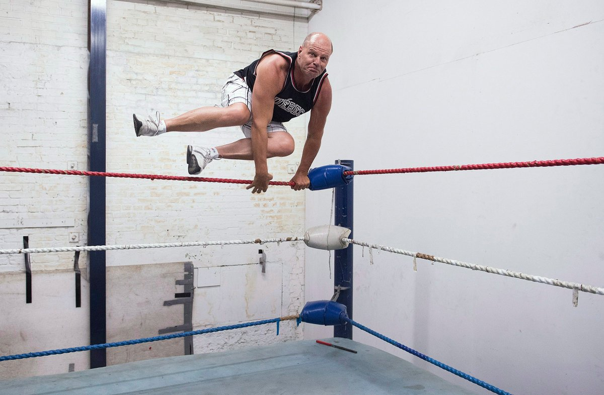 Former professional wrestler Jacques Rougeau leaps into the ring at his old wrestling school in Montreal, Friday, August 17, 2018.