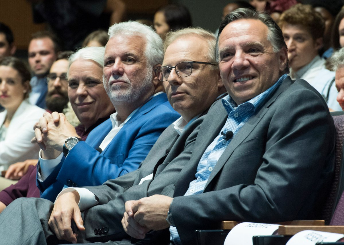 Québec Solidaire spokesperson Manon Massé, left to right, Quebec Premier Philippe Couillard, Parti Québécois leader Jean-François Lisée and CAQ leader François Legault participate in a youth-oriented event in Montreal, Friday, August 17 2018.