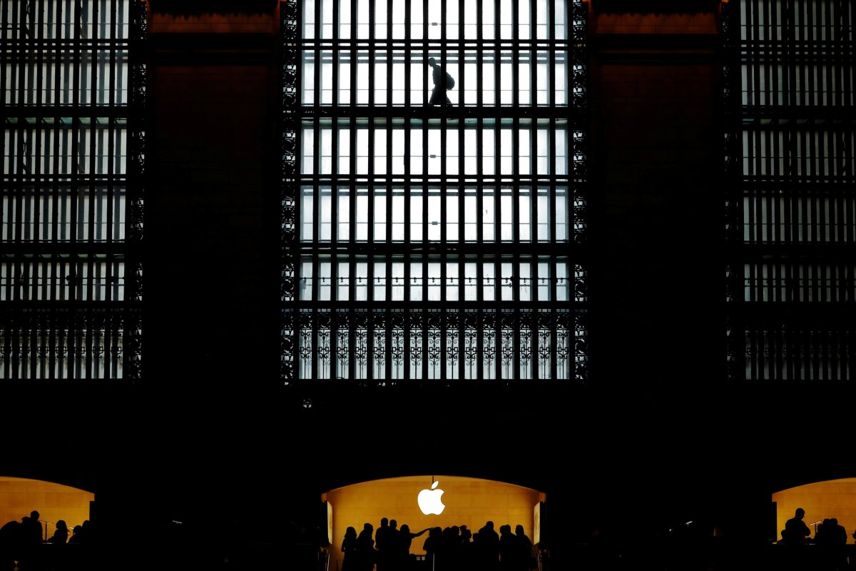 Customers walk past an Apple logo inside of an Apple store at Grand Central Station in New York, U.S., August 1, 2018.