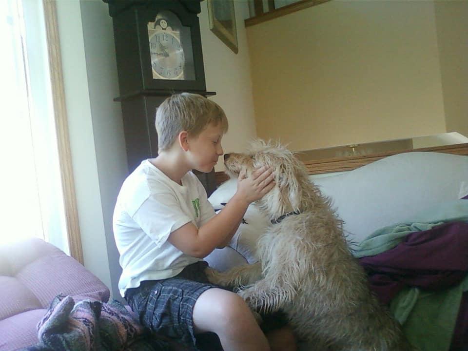 Ben Harris snuggles up to his dog, Pretzel.