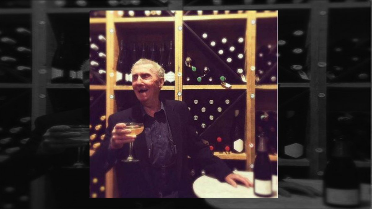Former bank robber Boyne Johnston is seen smiling and holding a glass of champagne in Riviera's wine cellar on Friday, Aug. 10, 2018.