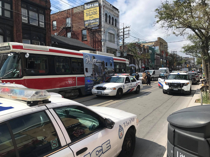 Toronto police arrest a man after he brought a replica sword onto the Queen Street streetcar.