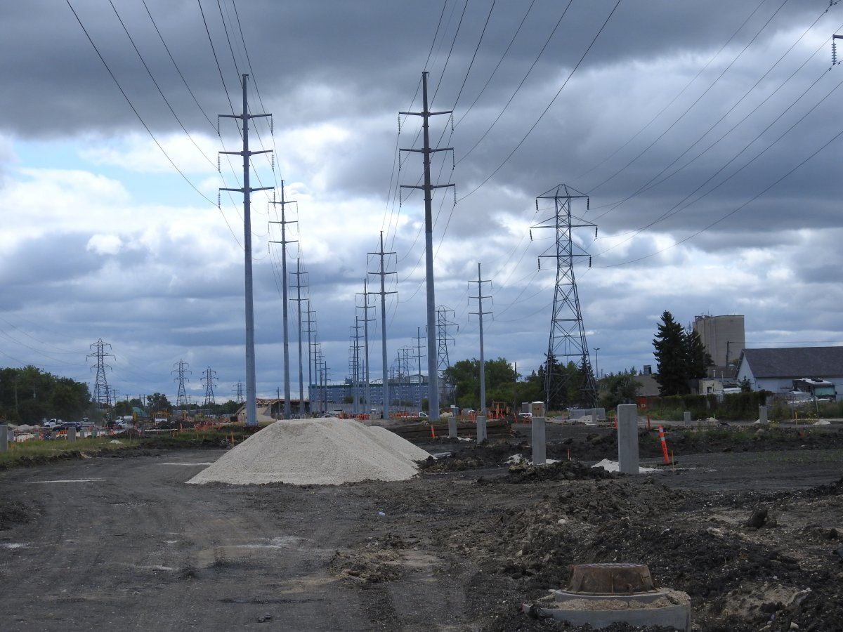 A pile of gravel directly underneath Manitoba Hydro transmission lines.