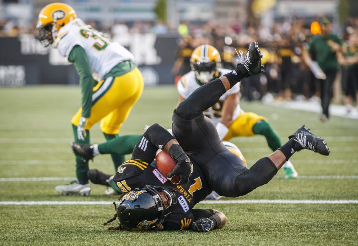 Hamilton Tiger-Cats' Alex Green scores a touchdown against the Edmonton Eskimos during the first half of CFL football action in Hamilton, Ontario on Thursday August 23, 2018.