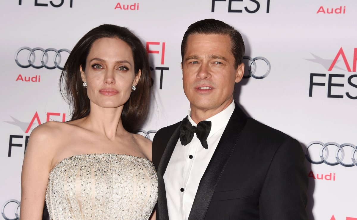 Angelina Jolie (L) and actor-producer Brad Pitt arrive at the AFI FEST 2015 presented by Audi Opening Night Gala Premiere of Universal Pictures' 'By The Sea' at TCL Chinese 6 Theatres on Nov. 5, 2015 in Hollywood, California.