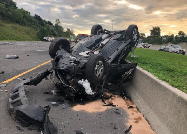 A car is turned over in a multi-vehicle crash on the westbound lanes of Hwy. 401 just east of Toronto on Aug. 31, 2018.